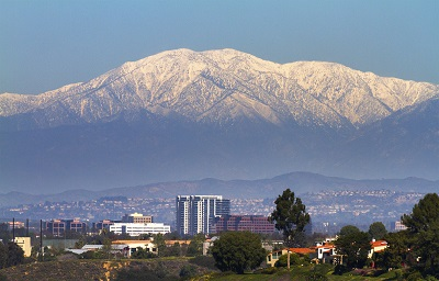 photo of city of Irvine with snow-capped mountains in the background